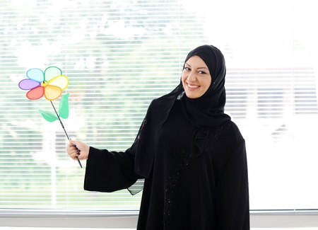 arab girl: Arabic muslim woman is smiling with a healthy teath Stock Photo