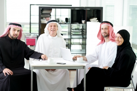 Arabic elderly business with his team at office  photo