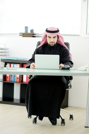 headcloth: Modern arabic businessman on office working on laptop