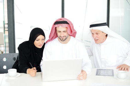 headcloth: Muslim business at work Stock Photo
