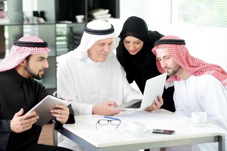 Muslim business at work Reklamní fotografie