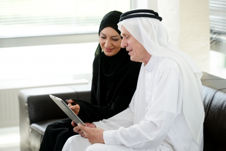 businees: Two couple muslim  on office with tablet