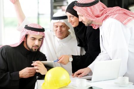 arab people: Portrait of araabic architect explaining his project Stock Photo