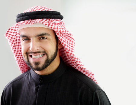 saudi: Modern arabic businessman,showing clean and healthy teath
