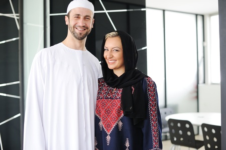 Two couple muslim standing on office  photo