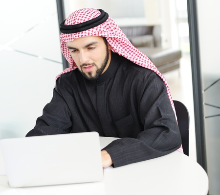 Modern arabic businessman on office working on laptop