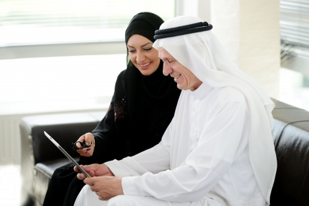 arabic woman: Business arabic people meeting indoor with electronic tablet