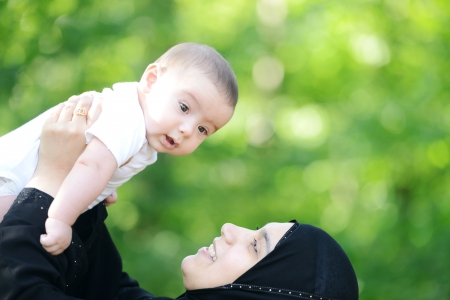 muslim baby: Mother and her baby enjoying in nature