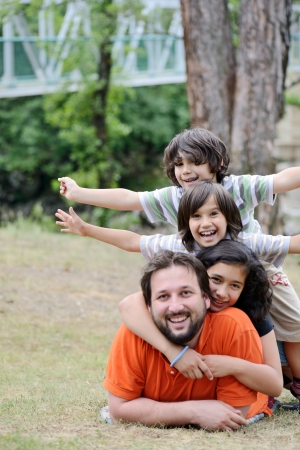 Portrait of happy family together in nature photo