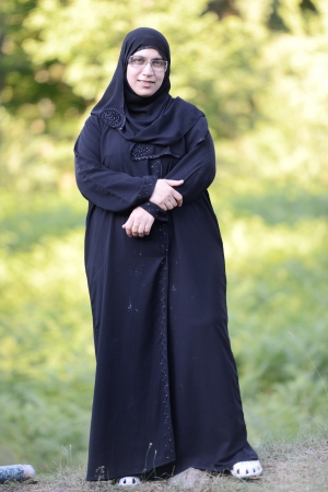 Muslim woman standing outdoor in nature photo