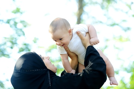 Mother and her baby enjoying in nature