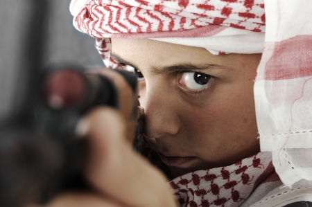 israel war: Kid warrior, soldier, shooting, rifle, toy (mixed race) Stock Photo
