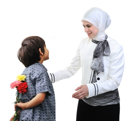 giving back: Muslim Arabic mother and son rose gift