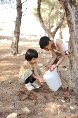 dirty man: Helping in washing hands with water in nature, children summer camp