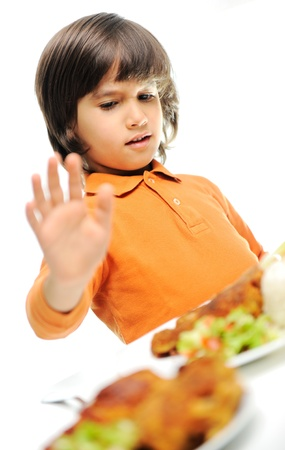 aversion: A little boy is heating a food, refusing food, kid does not want to eat