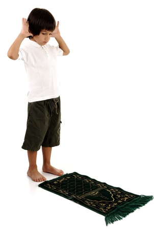 entire: Muslim kid praying - series of related photos showing the entire prayer