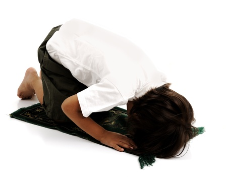Muslim kid praying - series of related photos showing the entire prayer
