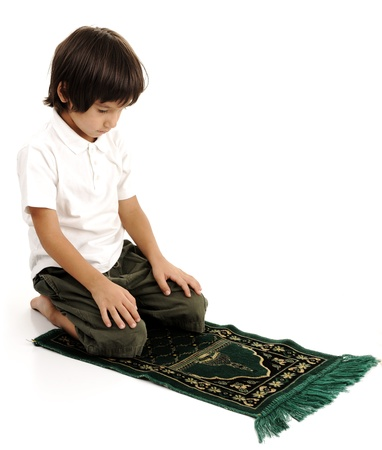 Muslim kid praying - series of related photos showing the entire prayer photo