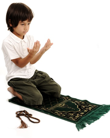islamic prayer: Muslim kid praying - series of related photos showing the entire prayer