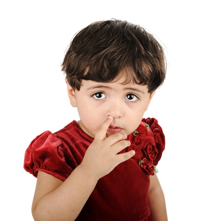 nose picking: Little girl looking up and picking nose Stock Photo