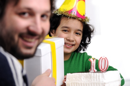 10 15 years: Father giving birthday present to 10 years old daughter Stock Photo