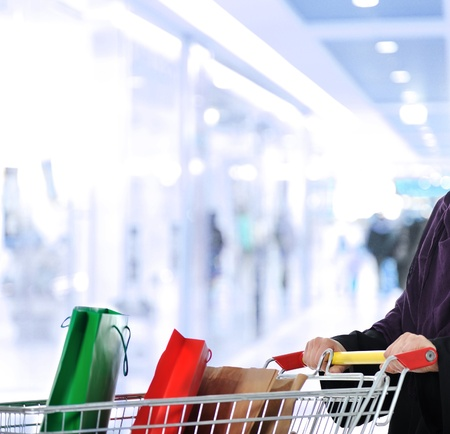 Image of  woman with cart looking