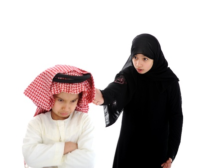 Arabian sister and brother arguing and fighting photo