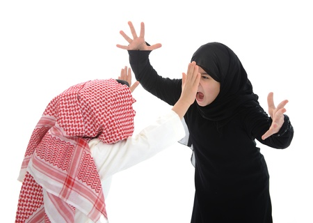 middle east fighting: Arabic Muslim girl and boy arguing and screaming at each other