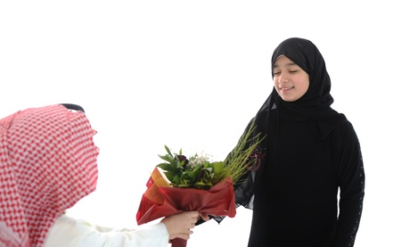 Arabic boy with keffiyeh and flowers present for sister photo