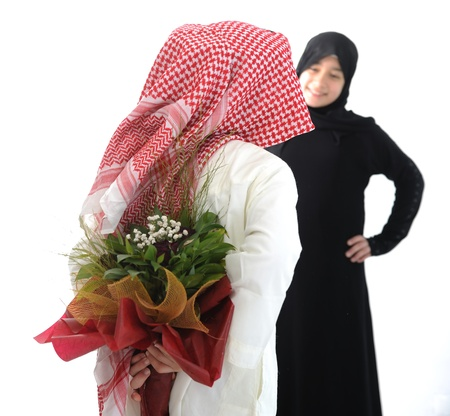 gift behind back: Arabian couple, roses and flowers as surprise