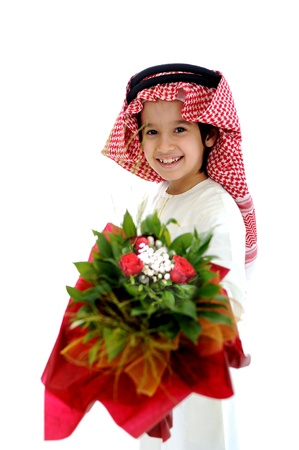 arab spring: Arabic Muslim kid with bouquet of flowers Stock Photo