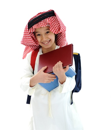 gulf: Arabic Middle Eastern school child with books