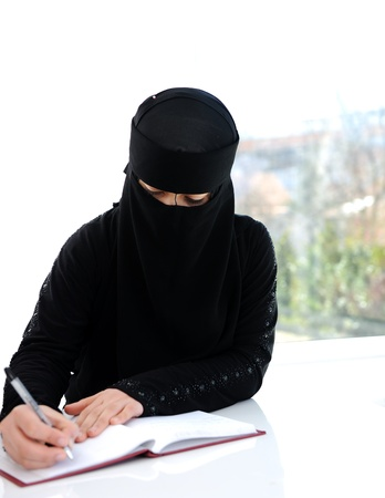 Middle eastern girl writing photo