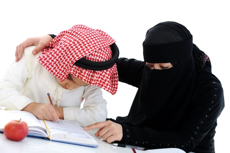 middle eastern ethnicity: Muslim Arabic boy and girl doing homework Stock Photo