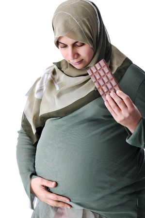 Pregnant muslim woman with chocolate photo