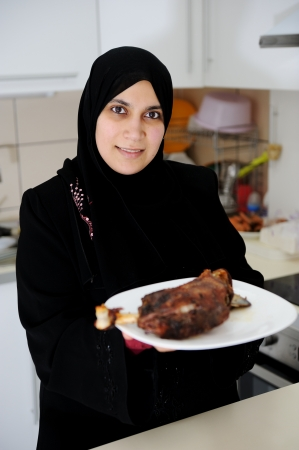 Beautiful muslim woman in the kitchen photo