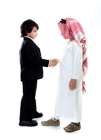 Arabic and caucasian little businessmen photo