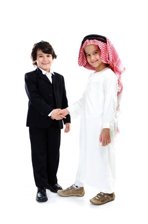 Arabic and caucasian little businessmen hand shaking Reklamní fotografie