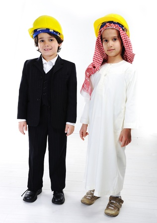 Caucasian and middle eastern little engineers photo