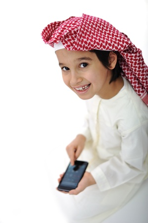 Little boy typing message on cell phone photo