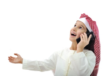 Arabic kid playing on phone in Ramadan photo