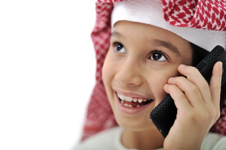 Little Arabic kid with phone photo