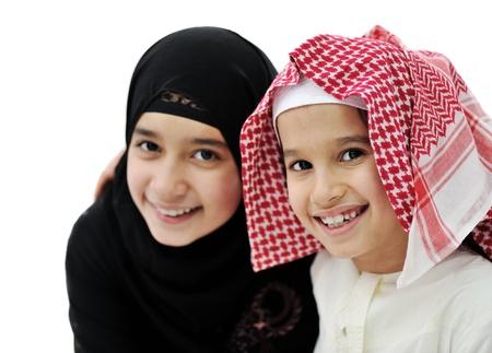 Portrait of little Arabic Muslim boy and girl