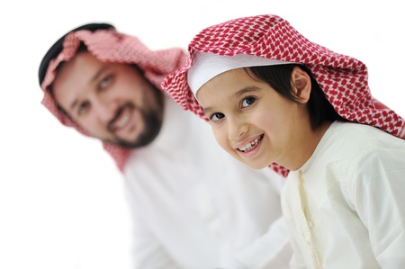 middle eastern clothes: Little boy and his father in traditional middle eastern clothes