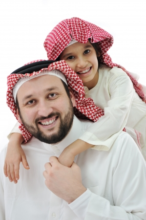 Arabic family, father piggybacking son