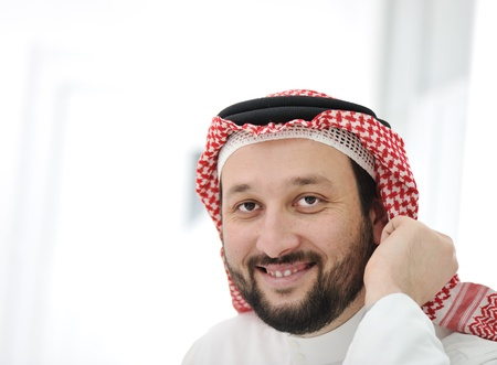 Arabic business man wearing traditional clothes photo