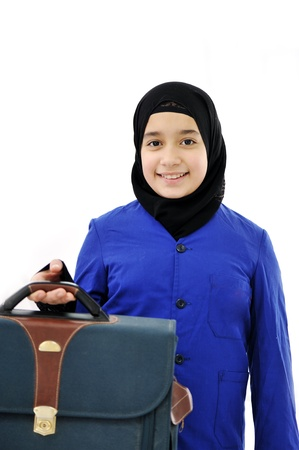 kids dress: Muslim girl with bag Stock Photo