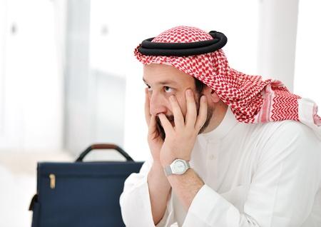 arabic man: Worried arabic businessman