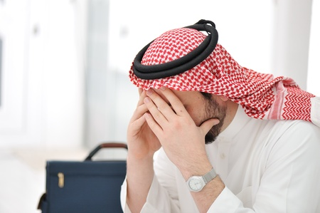 Sad middle eastern business man photo