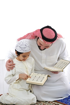 Father teaching little son photo